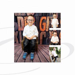 Junge sitzt während Kindergarten Fotoshooting auf Stuhl vor einem Fotohintergrund