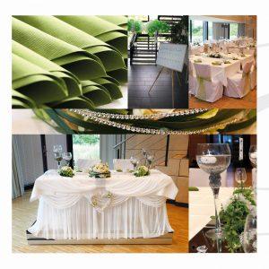 Dekoration in Grün mit Tischplan und grünen Stuhlschleifen